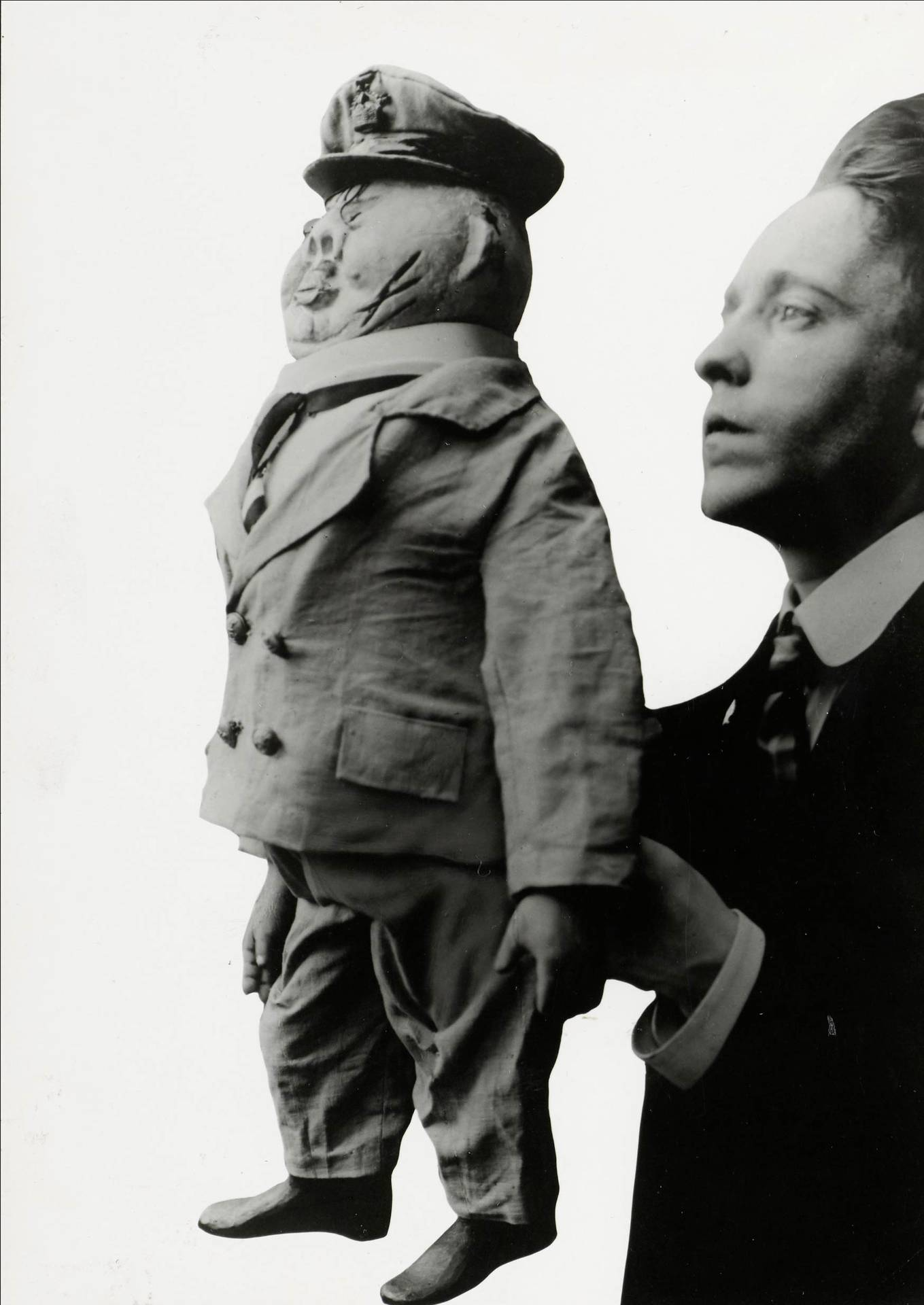 "John Heartfield with the puppet ""Der Konservative Herr"" (Conservative Gentleman), 1919"