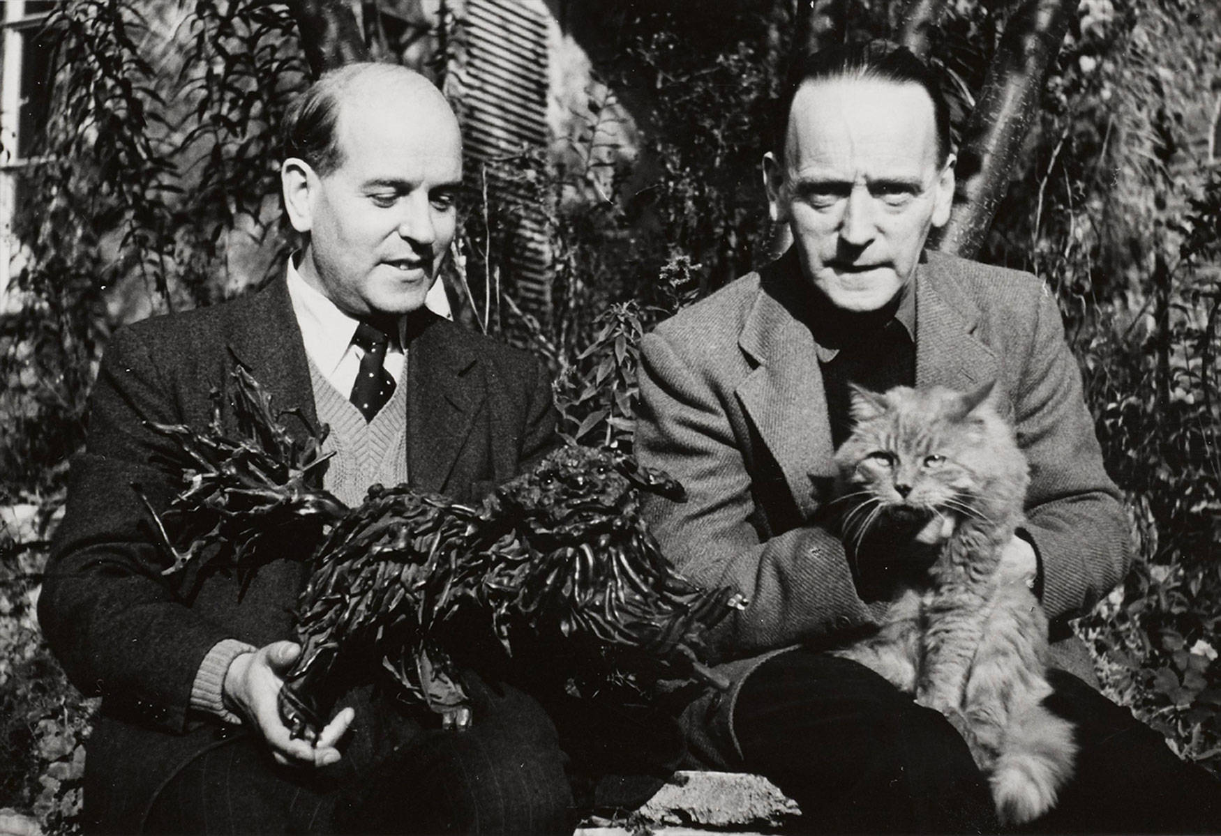 Wieland Herzfelde and John Heartfield with the chinese tea root lion, 1951