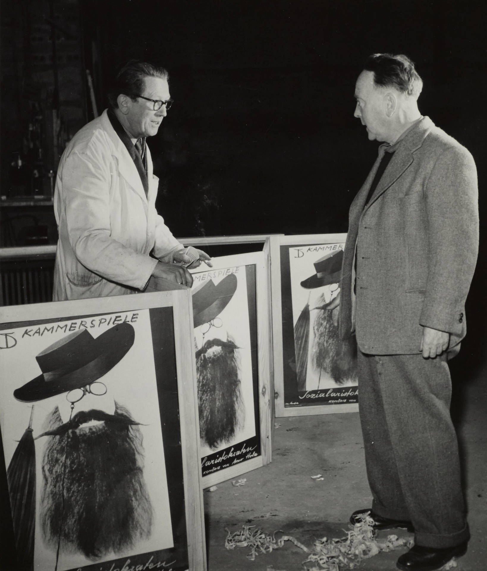 "John Heartfield with the poster for ""Sozialaristokraten"", 1955"