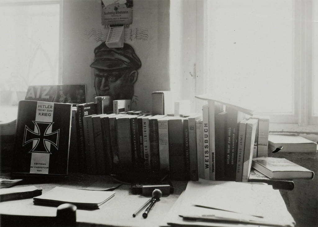 Heartfield's desk with books from his library stock