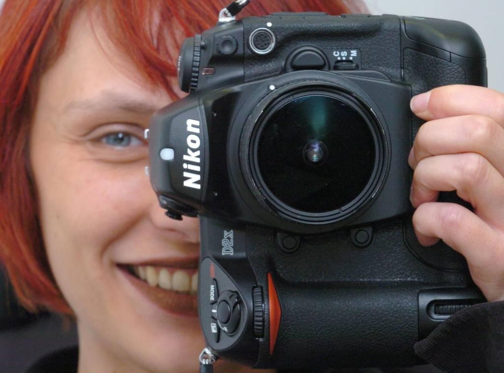 Tausende Bilder geschossen? Die schönsten kann man in einem Fotobuch sammeln. (Foto: dpa)