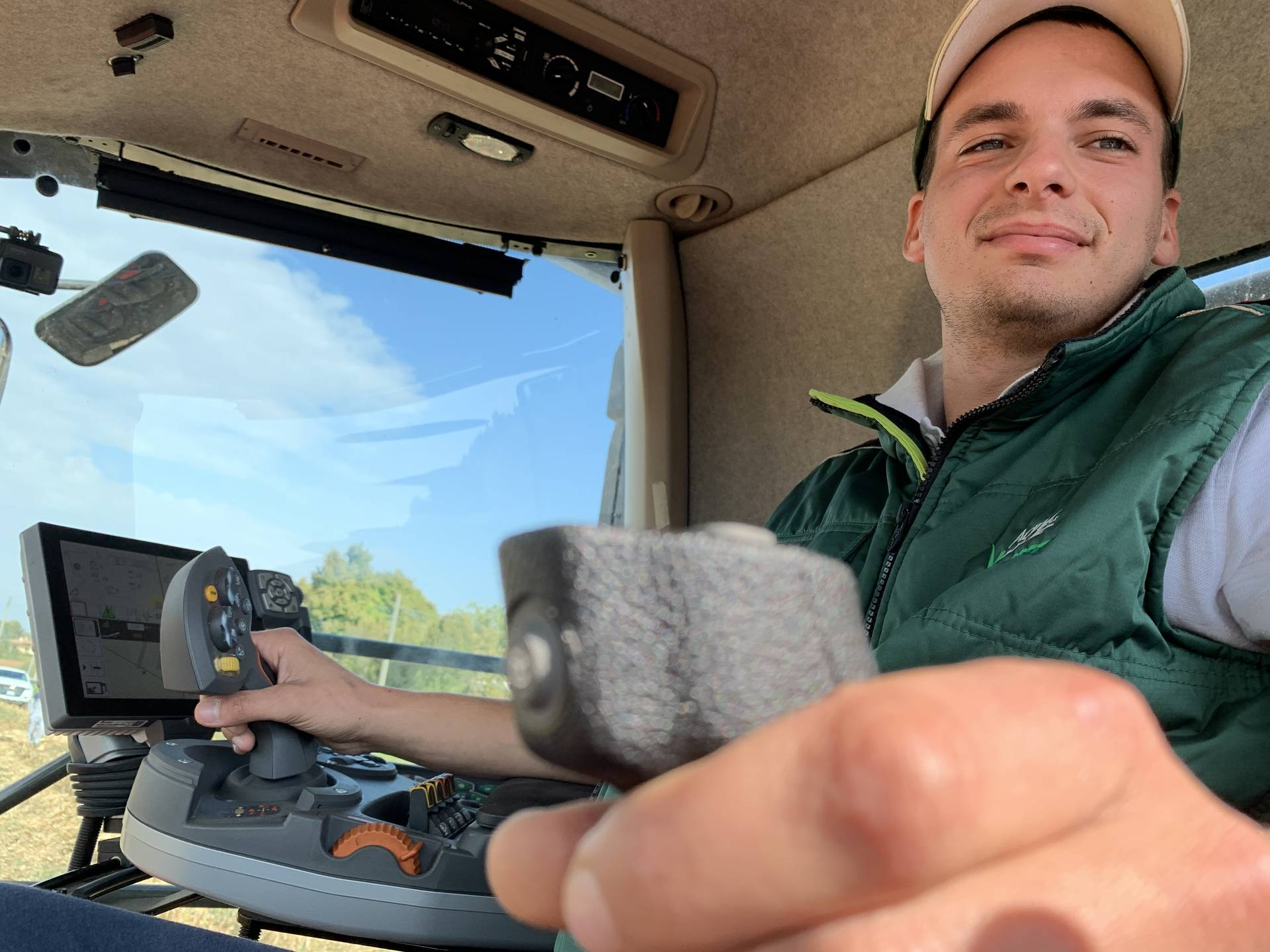 """Farmer Andrea Sandrini was a bit skeptical about the notion of joystick steering before taking the driver's seat. """"I am positively surprised. The joystick reacts fast and precisely to my hand movements. Steering this way is very easy,"""" he says."""